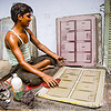 man cleaning an offset printing plate (india)