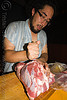 cook preparing meat, asado, chef, cook, hostel clan, knife, man, noroeste argentino, raw meat