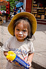 little girl holding party foam spray can - carnaval - carnival in jujuy capital (argentina), andean carnival, carnaval, child, hat, jujuy capital, kid, little girl, noroeste argentino, san salvador de jujuy, spray can