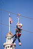 zip-line over san francisco, adventure, american flag, blue sky, cable line, cables, campanil, child, climbing helmet, clock tower, embarcadero tower, extreme sport, ferry building, gear, hanging, harness, justin herman plaza, kid, mountaineering, moving fast, speed, steel cable, trolley, tyrolienne, urban, us flag, zip line, zip wire, ziptrek