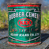 KKK rubber cement - very flamable?, asahi kako, box, can, cultural, flamable, glue, green, kkk, metal, red, rubber cement, rusty