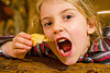 child holding toasted bread, apolline, blonde, breakfast, child, devouring, eating, honey, kid, little girl, making faces, mouth, teeth, toast, toasted bread