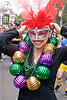 woman with carnival mask and large carnival beads, bay to breakers, carnival mask, costume, feather mask, festival, footrace, mardi gras beads, mardi gras mask, masquerade mask, necklaces, red feathers, street party, woman