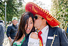 mexican couple, bay to breakers, costume, couple, festival, footrace, hat, kissing, man, mexican, red sombrero, street party, woman