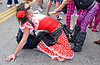 man wearing red flamenco dress, alvaro, bay to breakers, drag, festival, flamenco costume, flamenco dress, footrace, man, red flower, street party