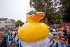 ducky float, bay to breakers, carnival float, cigar smoking, costume, crowd, festival, footrace, giant ducky, street party, yellow