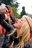 drinking from a water gun, bay to breakers, blonde, costume, drinking, festival, footrace, head band, squirt gun, street party, toy gun, water gun, water pistol, woman