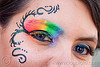 rainbow eye makeup, blue contact lenses, blue contacts, color contact lenses, colored lenses, dolores park, eye makup, face painting, facepaint, gay pride festival, rainbow colors, rainbow makeup, woman