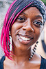 black woman with pink hair, black woman, gay pride festival, lip piercing, pink hair