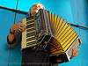 playing accordion, accordeon, accordion player, anderson system, blue, haight street, piano accordion, sparrow, yellow