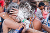 couple sprayed by party foam - carnaval de tilcara (argentina), andean carnival, carnaval, couple, foam spray, man, noroeste argentino, party foam, quebrada de humahuaca, splashed, tilcara, woman