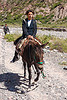 woman riding horse (argentina), bridle, horse-riding, horseback riding, iruya, noroeste argentino, pony, quebrada de humahuaca, river bed, san isidro, trail, woman
