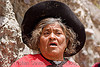 old woman singing (argentina), black hat, indigenous, iruya, noroeste argentino, old woman, quebrada de humahuaca, quechua, red, san isidro, singing