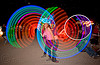 spinning light hulahoops - burning man 2010, burning man, hooping, hula hoops, kaylyn, led hula, light hulas, night, woman