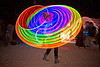spinning light hulahoop - burning man 2010, burning man, hooping, hula hoops, kaylyn, led hula, light hulas, night, rainbow colors, woman