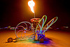 dragonfly art car, art car, burning man, chris merrick, dragonfly, el-wire, fire, flames, glowing, night, now-a-saurus, wheel, wings