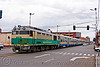 train sharing street with cars - oruro (bolivia), cars, de 953, diesel electric, enfe, expreso del sur, fca, locomotive, oruro, railroad tracks, rails, railway tracks, street, traffic lights, train engine