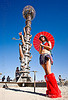 woman with red japanese umbrella near the tower, burning man, japanese umbrella, red umbrella, the minaret, woman