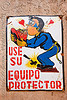 """use su equipo protector"" safety sign - potosi (bolivia), cerro rico, hearts, kissing, man, mina candelaria, mine worker, miner, mining, potosí, safety equipment, safety helmet, safety sign"