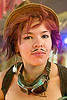 girl with fake mustache, asian woman, burning man, center camp, fake moustache, fake mustache, false moustache, false mustache, goggles, hat, makeup, moustaches, mustaches, redhead, roxy doll