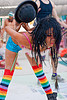 dancing with a bowler hat - mumu, bowler hat, burning man, center camp, mumu, performance, rainbow colors, rainbow stockings, rainbow tights, woman