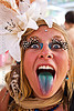 blue tongue - sticking tongue out, blue tongue, burning man, center camp, feather eyelashes extensions, hat, headdress, headwear, jenni, sticking out tongue, sticking tongue out, white flowers, woman