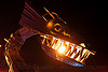 metal dragon head with fire, animated, art car, burning man, fire, flame, kinetic, metal, night, sculpture, teeth, tin pan dragon