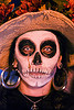woman with skull makeup - white contact lenses - Día de los muertos - halloween (san francisco), color contact lenses, day of the dead, dia de los muertos, earrings, face painting, facepaint, halloween, makeup, night, special effects contact lenses, straw hat, theatrical contact lenses, white contact lenses, white contacts, woman