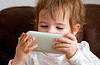 kid playing video game on iPhone, cellphone, child, iphone, kid, little girl, playing, video game