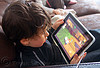 kid playing a video game on an iPad, boy, child, ipad, kid, playing, tablet computer, video game