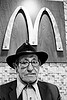 old man at mcdonalds restaurant, eyeglasses, eyewear, fast food, golden arches, hat, logo, mcdonalds, old man, pedro lopez-brito, pedro lópez-brito, prescription glasses, restaurant, spectacles