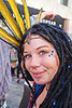 woman with blue bindis and yellow feather headdress, bindis, feather headdress, how weird festival, woman