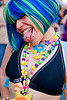 kandi raver with mouth piercing - blue wig, beads, blue wig, how weird festival, kandi kid, kandi raver, lip piercing, necklaces, plur, rave fashion, sticking out tongue, sticking tongue out, tongue piercing, woman
