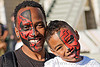 tribal red face paint - father and son, african american man, black man, carnival, child, father, half face, kid, red, son, tribal facepaint