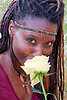 black woman with yellow rose, black woman, dreadlocks, dreads, flower, headband, lala love, nose piercing, nose ring, nostril piercing, spring training, yellow rose