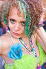 raver girl with green hair and green fuzzy bra, blue flower, fuzzy bra, gay pride festival, green eyed, green eyes, green hair, kathleen, woman