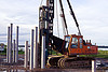 hydraulic pile driver, at work, beluran, building construction, building foundations, columns, foundation works, groundwork construction, heavy equipment, hydraulic hammer, machinery, pile driver, pile driving, precast concrete piles, reinforced concrete, working