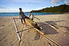 double outrigger fishing canoe on beach