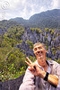 happy to have reached the mulu pinnacles (borneo), erosion, geology, gunung mulu national park, jungle, karst, karstic, limestone, man, peace sign, pinnacles, rain forest, rock, self-portrait, selfie, stone, tristan savatier, v-sign