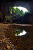 deer cave mouth at garden of eden - mulu (borneo), backlight, cave mouth, caving, deer cave, garden of eden, gunung mulu national park, jungle, natural cave, pebbles, rain forest, reflection, spelunking, trees, water