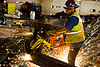 worker cutting rail with handheld abrasive  saw, 3120x, abrasive saw, cut-off saw, cutting, headlamp, headlight, high-visibility jacket, high-visibility vest, huskvama, light rail, man, muni, night, ntk, power tool, railroad construction, railroad tracks, rails, railway tracks, reflective jacket, reflective vest, safety glasses, safety gloves, safety helmet, safety vest, san francisco municipal railway, sparks, track maintenance, track work, worker, working