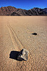 sailing stones on the racetrack (death valley), cracked mud, death valley, desert, dry lake, dry mud, mountains, racetrack playa, sailing stones, sliding rocks, tracks