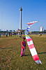 kid flying a kite near the national monument (monas) in jakarta