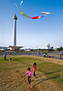 kids flying a kite near the national monument (monas) in jakarta, architecture, children, column, eid ul-fitr, flying, girls, jakarta, java, kids, kite, medan merdeka, merdeka square, monas, monumen nasional, national monument, park, turf