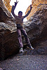 jumping down - grotto canyon, death valley, desert, grotto canyon, jump, jumper, jumping down, jumpshot, mountain, peace sign, rock, sharon, slot canyon, stone, v sign, woman
