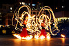 fire performers - fire dancing expo (san francisco), fire dancer, fire dancing expo, fire dress, fire hoop dress, fire hoops, fire hula hoops, fire performer, fire spinning, flames, long exposure, night, spinning fire, temple of poi
