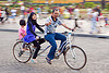 father and daughters riding tandem, child, daughters, family, father, girl, hijab, islam, jakarta, java, kid, man, medan merdeka, merdeka square, moving, muslim, park, people, riding, road, tandem bicycle, tandem bike, thumb up, woman