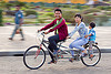 family riding tandem bike