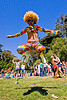 colorful woman jumping, afro hair, bay to breakers, festival, footrace, golden gate park, jump, jumpshot, street party, turf, woman