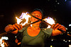 savanna with double fire staff, crossed, double staff, fire dancer, fire dancing, fire performer, fire spinning, fire staffs, fire staves, flame, night, savanna, spinning fire, woman